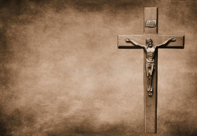 Crucifix on large sepia toned background stock photography