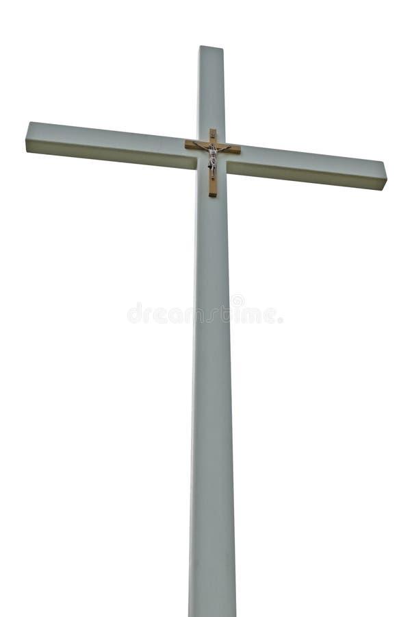Crucifix light grey isolated catholic cross. Large crucifix, light grey isolated catholic cross, vertical perspective royalty free stock photography