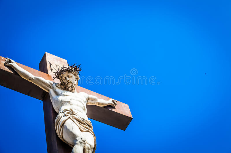 Crucifix. Made of marble with blue sky in background. France, Provence Region stock image
