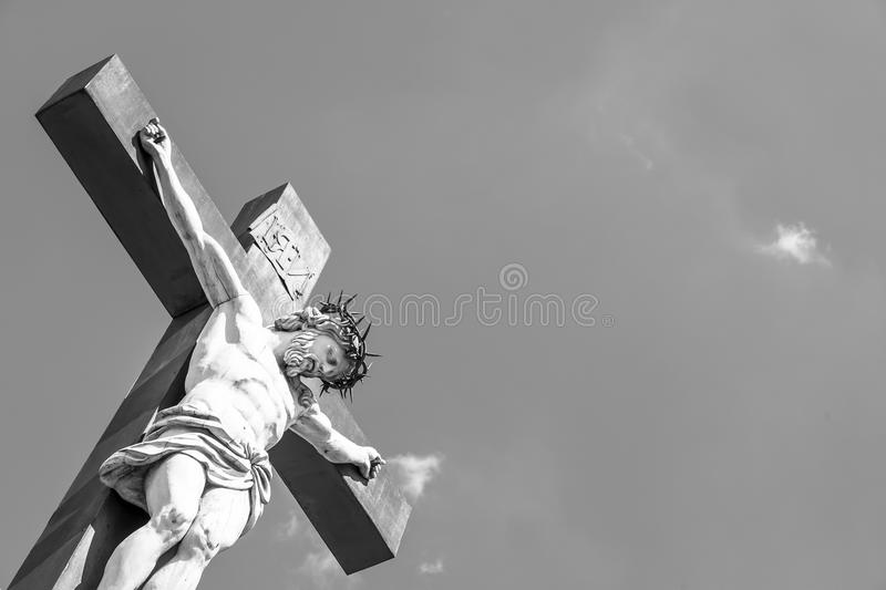 Crucifix. Made of marble with blue sky in background. France, Provence Region royalty free stock photo