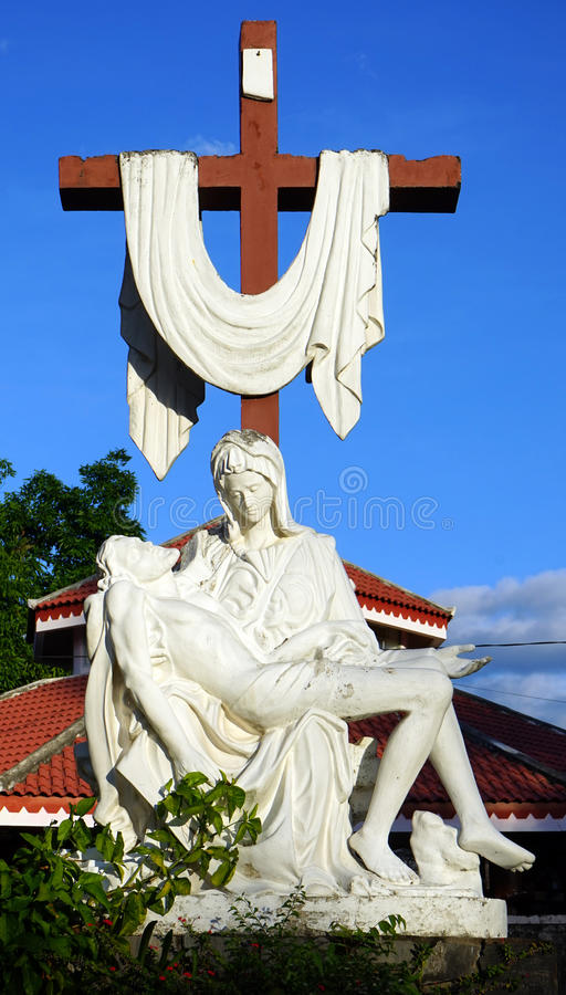 Crucifix near Wooden Church stock photos