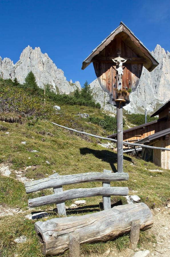 Crucifix next to the cottage Rifugio Citta di Carpi, Dolomites in South Tyrol. Old Crucifix next to the cottage Rifugio Citta di Carpi, Dolomites in South Tyrol stock image