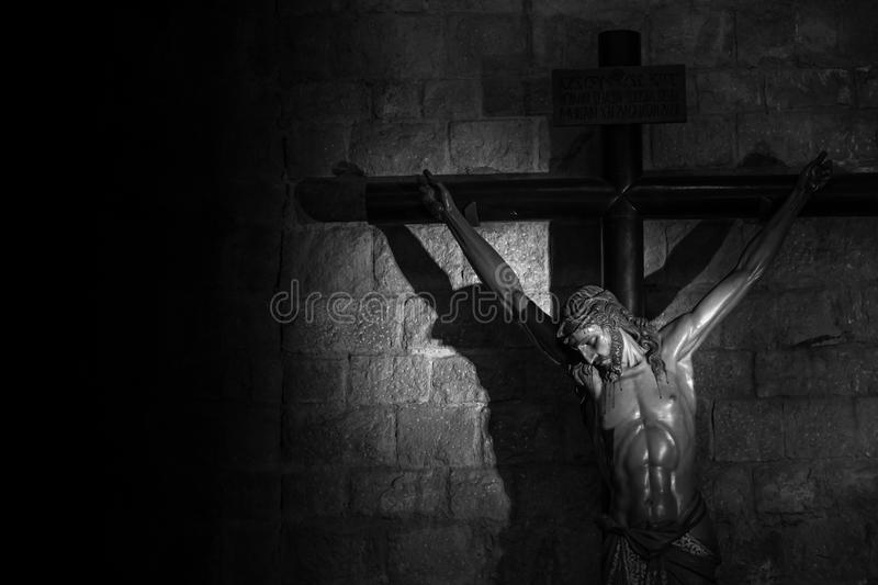 Crucifix. Old medieval crucifix in Italian church - made of wood stock image