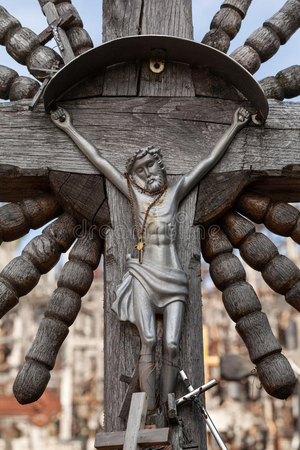 Crucifix. Old wooden crucifix in Hill of Crosses in Lithuania stock images