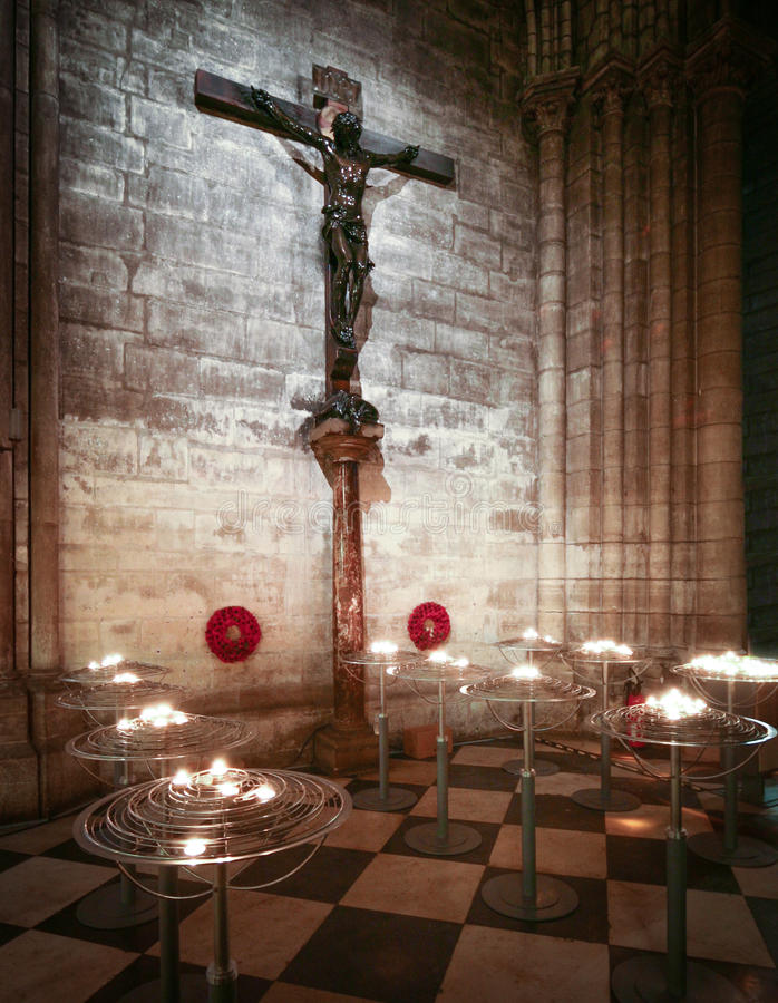 Crucifix and prayer candles stock photography