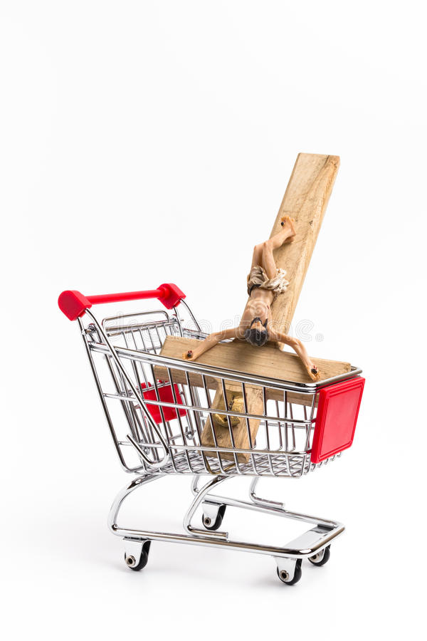 Crucifix in shopping cart. Conceptual representation of commodification of religion, loss of faith, blasphemy stock images
