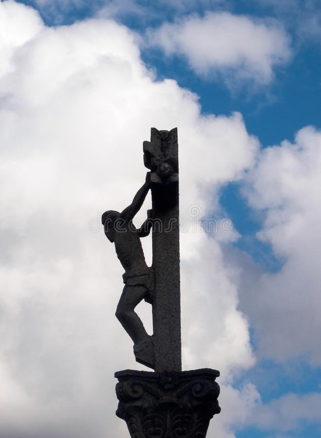 Crucifix silhouette - Calzadilla de los Hermanillos. Silhouette of an old stone roadside crucifix - Calzadilla de los Hermanillos, Castille and Leon, Spain royalty free stock photos