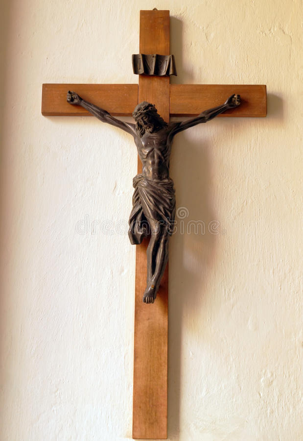 Crucifix on wall of old church. Catholic crucifix from dominican monastery royalty free stock photo