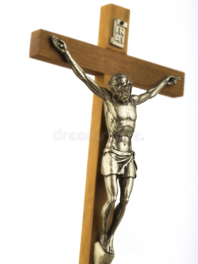 Crucifix. Wooden crucifix with effigy of Christ, closeup, with glow effect, vertical format royalty free stock photos