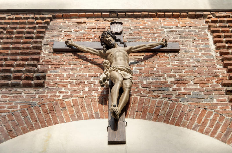 Crucifix. Wooden crucifix of Jesus Christ on the wall royalty free stock images