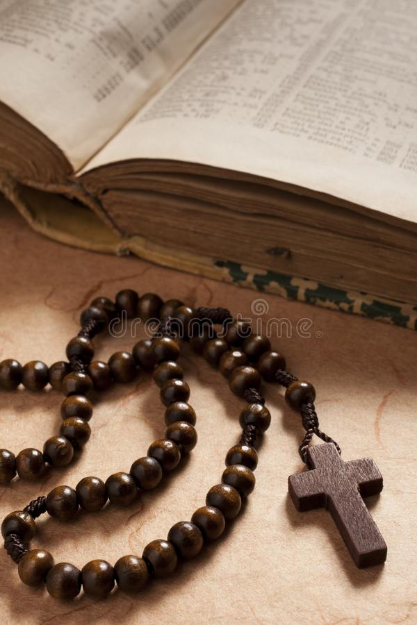 Crucifix wooden rosary and book stock photo