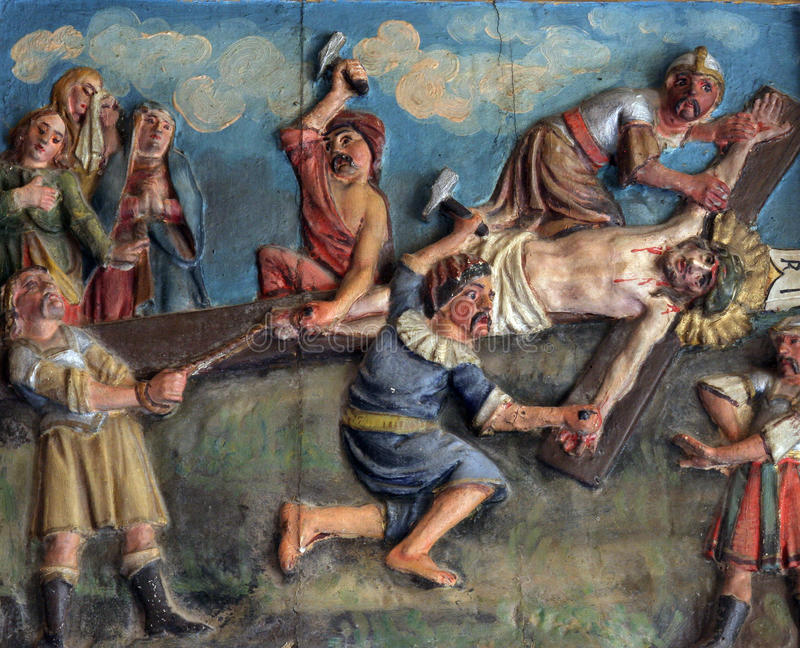 Crucifixion: Jesus Is Nailed To The Cross Stock Photo - Image of ...