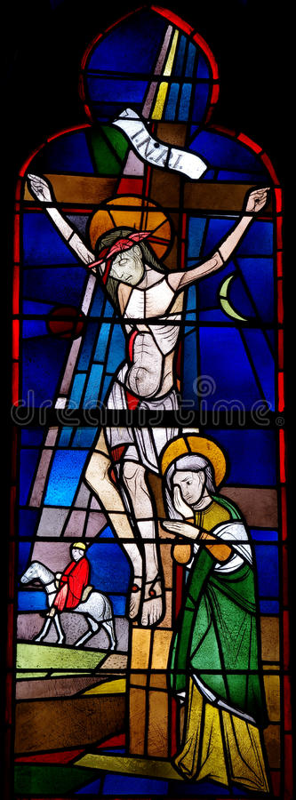 Crucifixion of Jesus in stained glass. Stained glass window of the crucifixion of Jesus royalty free stock images