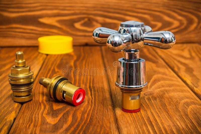 Cruciform hot and cold water main switch of spare parts stock photography