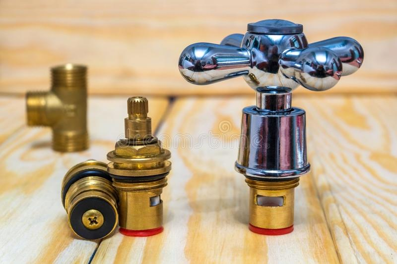 Cruciform hot and cold water main switch of spare parts royalty free stock photos
