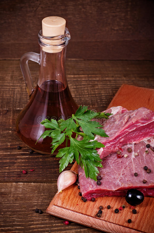 Crude meat and spice royalty free stock images