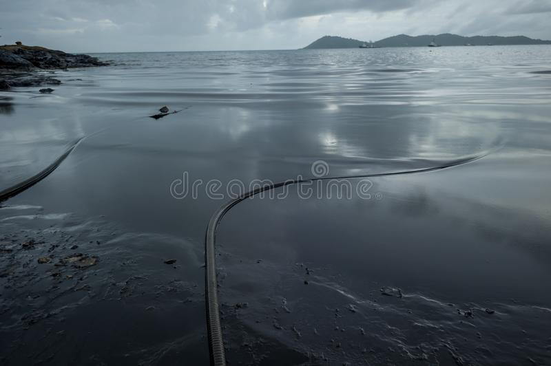 Crude oil along the beach of Ao Phrao after a nearby oil spill in Gulf of Thailand royalty free stock photography