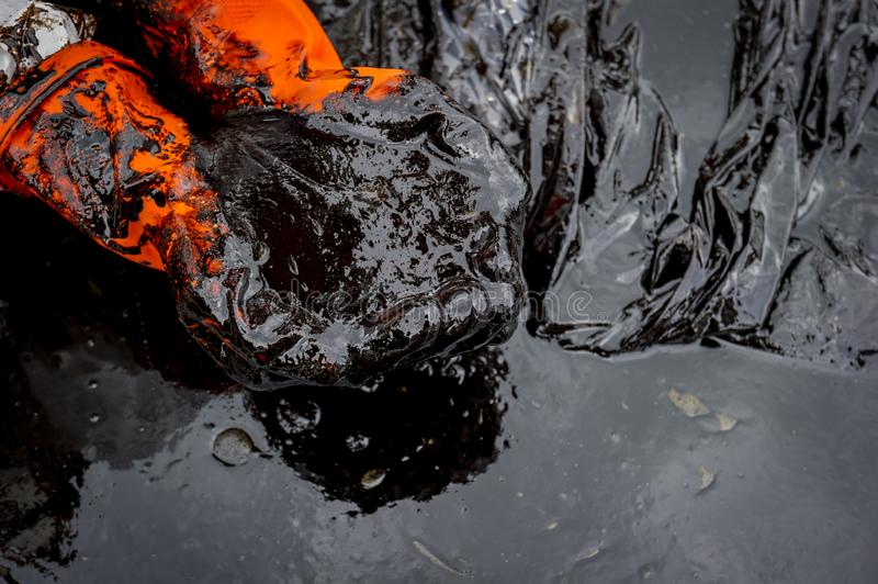 Crude oil along the beach of Ao Phrao after a nearby oil spill in Gulf of Thailand royalty free stock images