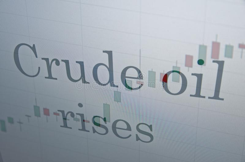 Crude oil rises. Inscription Crude oil rises on PC screen. Financial concept stock photography