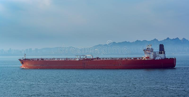 Crude oil tanker in front of Qingdao coastline. stock photos