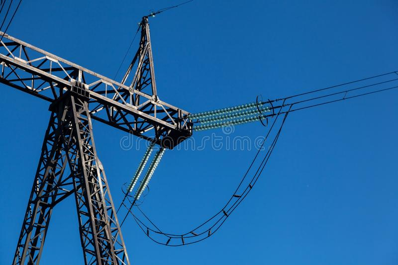 Crude plan metal high-voltage pole. With lots of wires against a blue sky royalty free stock photos