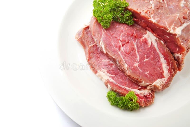 Crudo cortado de la carne de la carne de vaca o del filete del ojo de la costilla imagen de archivo libre de regalías
