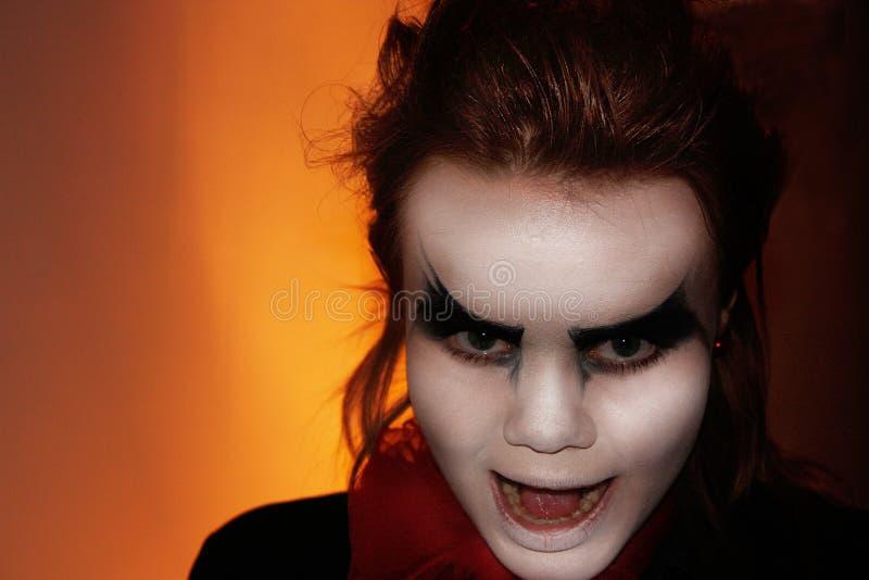 Cruel girl with dark eyes. Vampire royalty free stock images