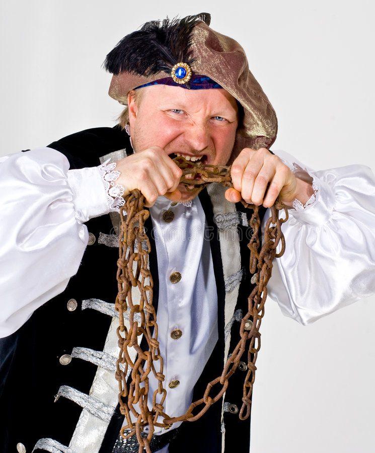 Cruel landlord. A theatrical actor posing as a cruel landlord with rusty chains royalty free stock image