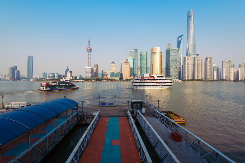 Cruis Ships in Shanghai, China. Shanghai, China - Oct 11,2015: Cruising ships on the Huangpu river and the skyline of Pudong business district in Shanghai stock image