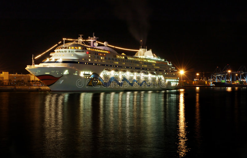 Cruise boat at night royalty free stock images