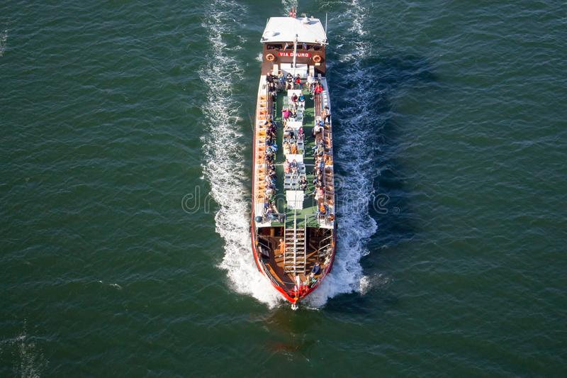Cruise boat with people top view. Touristic ship on river Douro. Summer voyage. Cruise journey. royalty free stock photography