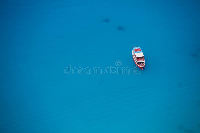Cruise boat seen from above on clear blue water stock photo
