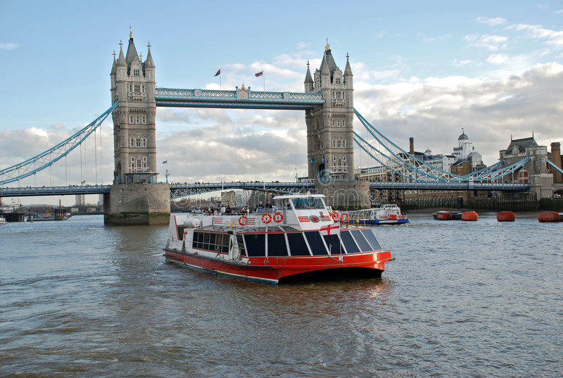 Cruise boat and Tower Bridge stock photos