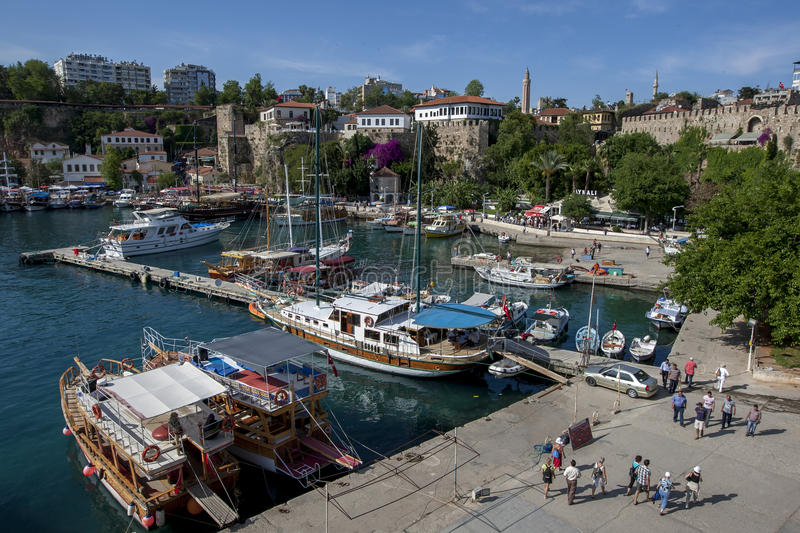 Cruise boats docked in Kaleici Harbour in the old town section of Antalya, Turkey. stock images