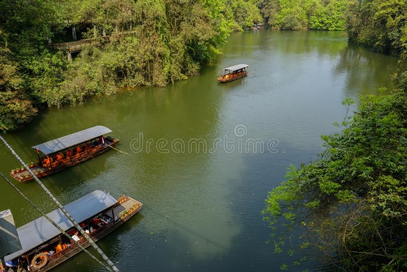 Cruise boats on lake in sunny spring afternoon. Cruise boats on the lake in sunny spring afternoon,Pujiang county,Chengdu,China stock photo