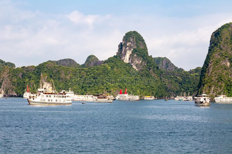 Cruise boats sailing among the karst formations in Halong Bay, Vietnam, in the gulf of Tonkin stock photos