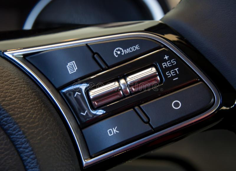 Cruise control buttons on the steering wheel.  stock image