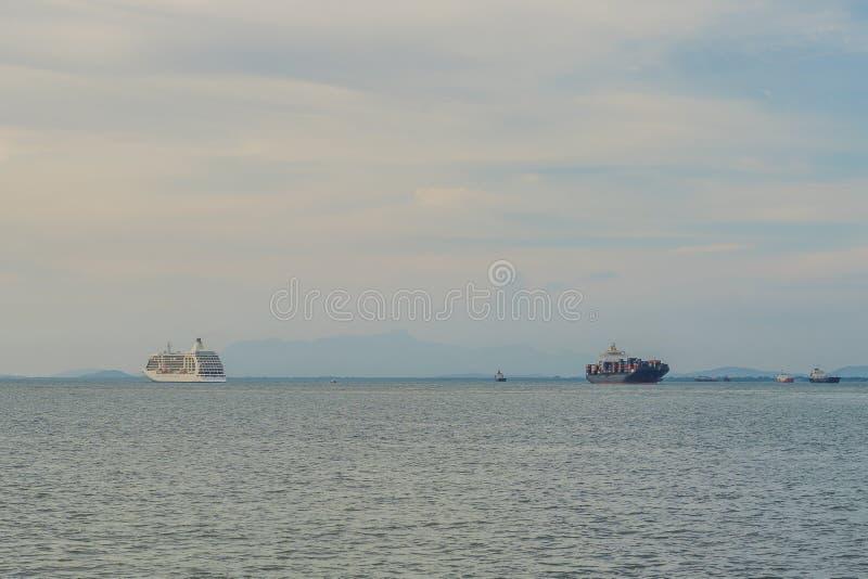 Cruise liner and cargo ship on the horizon stock photos