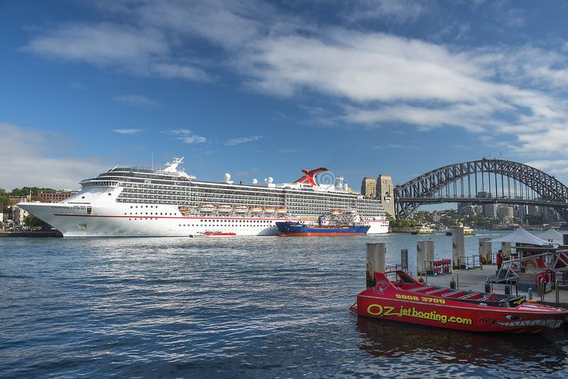Cruise liner Carnival Legend parked in the Sydney Harbour, Sydney, Australia. Sydney, Australia - March 24, 2018: ocean cruise liner Carnival Legend parked in royalty free stock photos