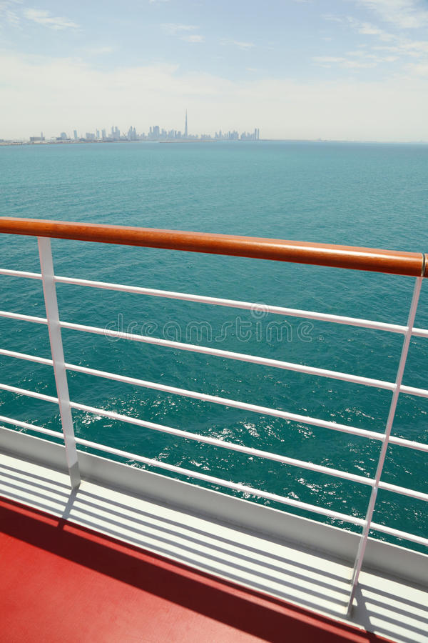 Cruise liner deck with red floor and wooden rail stock image