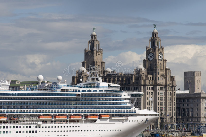 Cruise Liner in Liverpool. Cruise liner berthed in Liverpool UK with the famous skyline including the Liverbirds in the background royalty free stock images