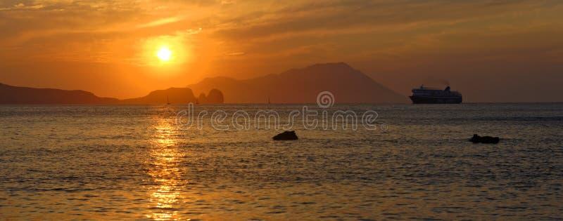 Cruise liner sailing at sunset royalty free stock photography