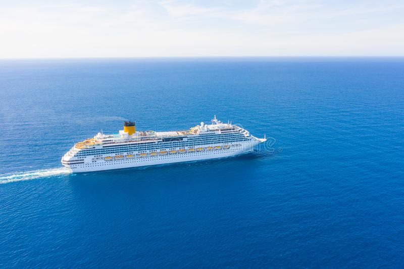 Cruise liner sails on the high seas on a trip to another mainland. Aerial view. Concept of sea tours, marine luxury vacation royalty free stock image