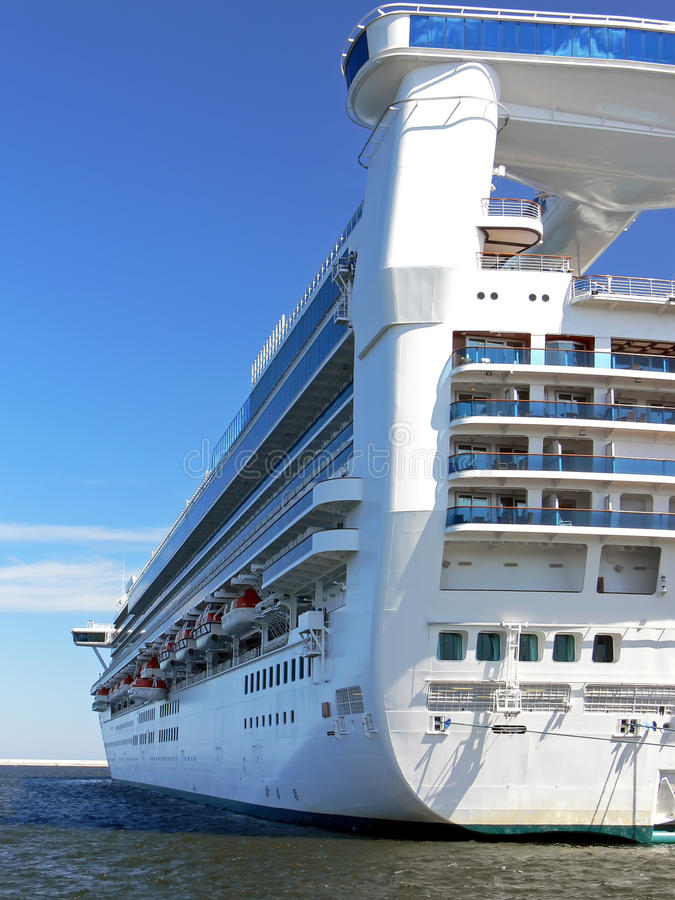 Cruise liner stern. A view of the white cruise liner on the blue sky royalty free stock image