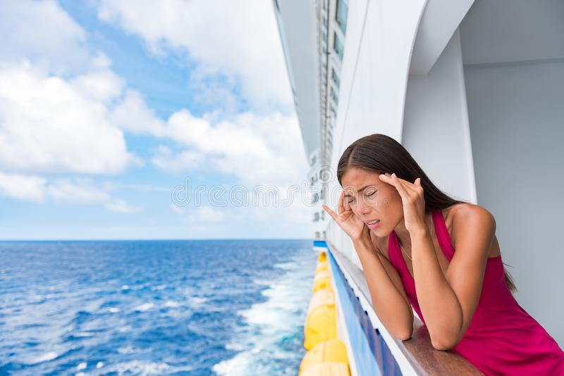 Cruise sea motion sickness tourist woman seasick on boat vacation with headache or nausea. Fear of travel or illness virus on stock images