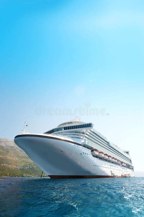 Cruise ship in the Adriatic Sea. Large modern white cruise ship in the Adriatic sea with the coastline in the background stock photos