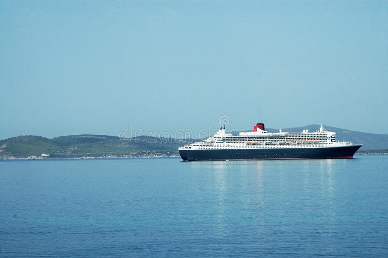 Cruise ship. Queen Mary 2, largest cruise ship in the world in port of Alghero - Sardinia - Italy stock photos