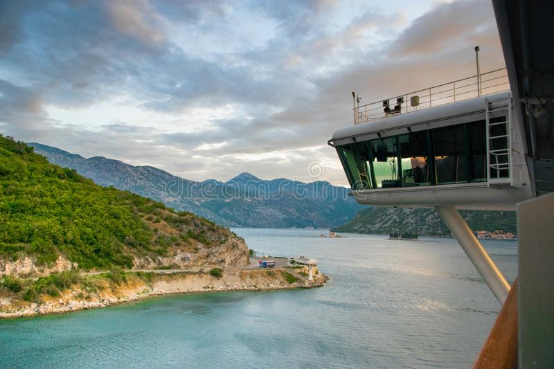 Cruise ship bridge coming into Montenegro Kotor Bay with views of tall mountains before sunrise stock image
