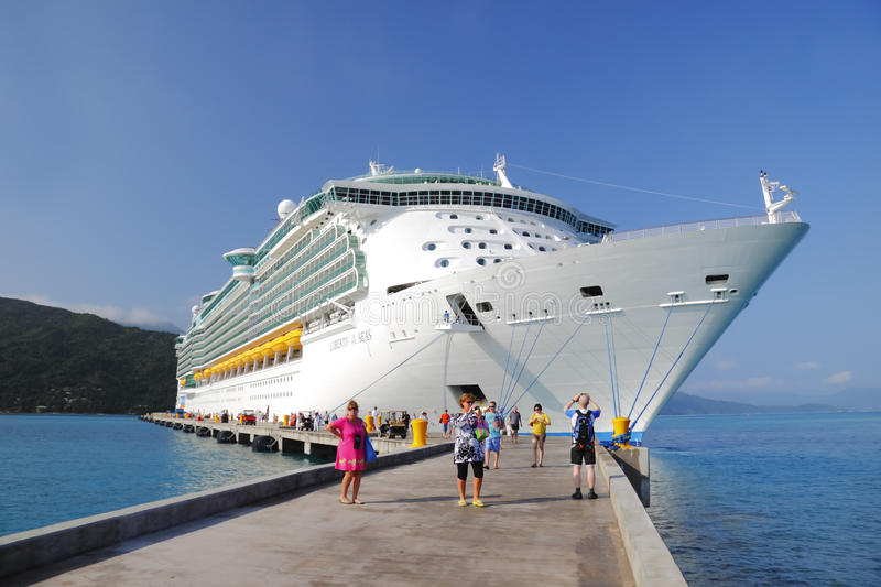 Cruise Ship Caribbean Haiti. Cruise ship is docked in Haiti, Caribbean and delivers much needed relief and financial support via holidaymakers. Ship is Royal