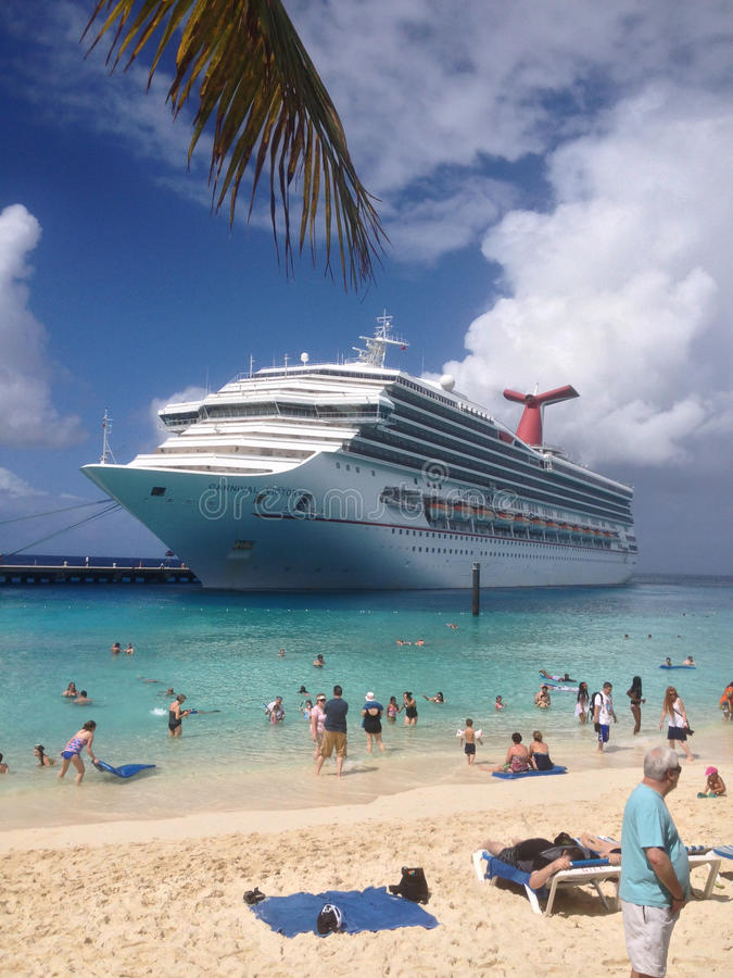 Cruise Ship-Carnival Victory docked by the beach. royalty free stock image